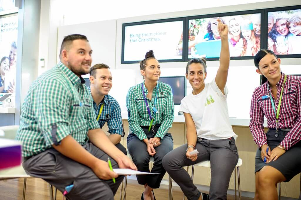 Team listening to conference in store