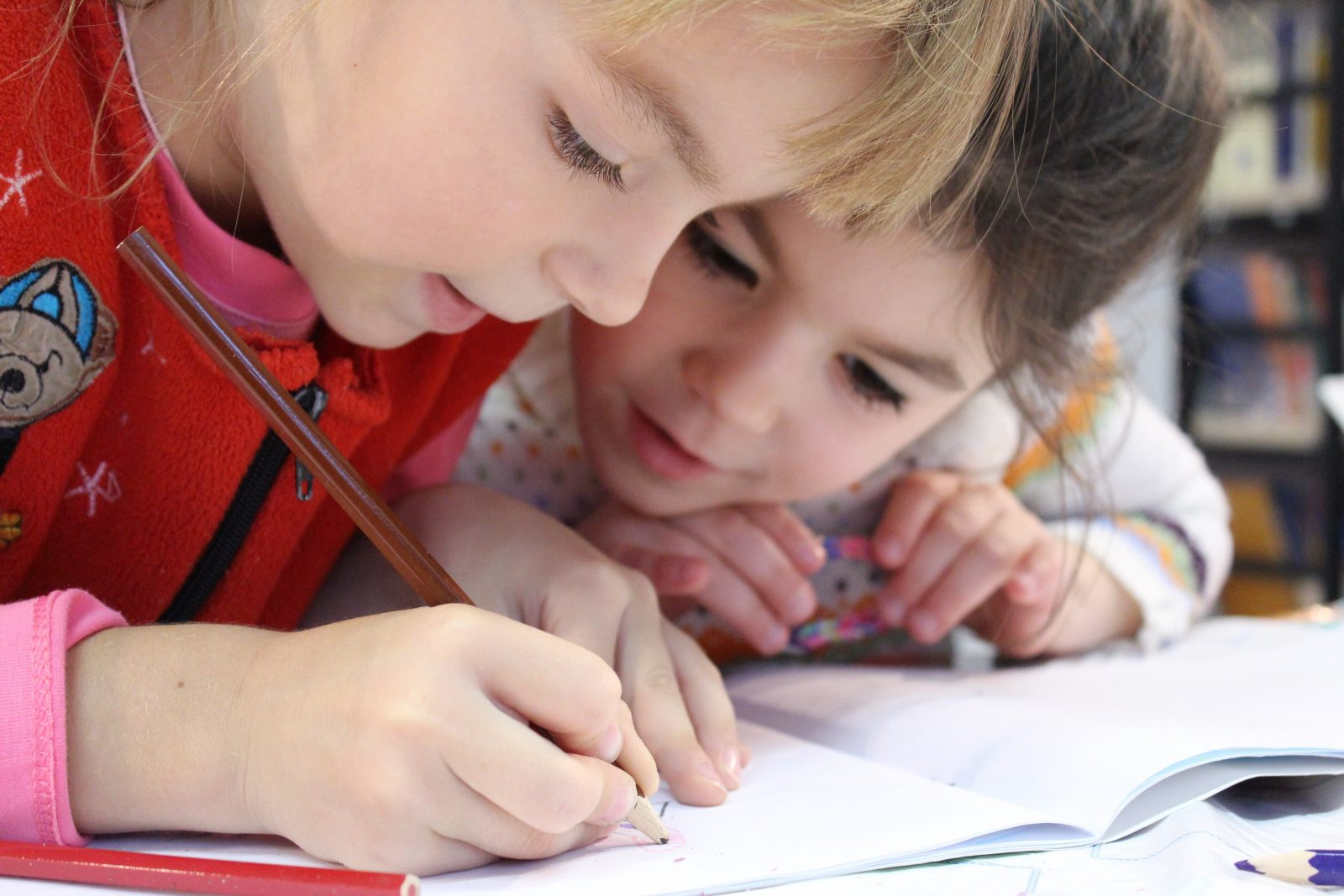 Children writing in notebook