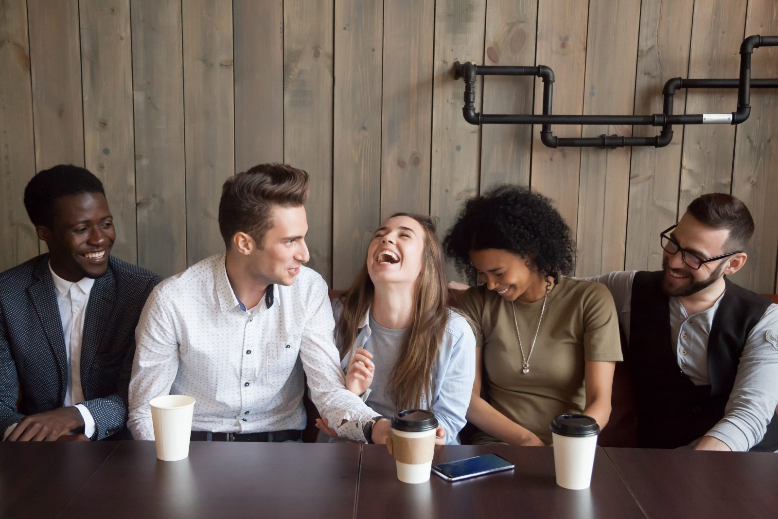 Team of young professionals laughing during meeting